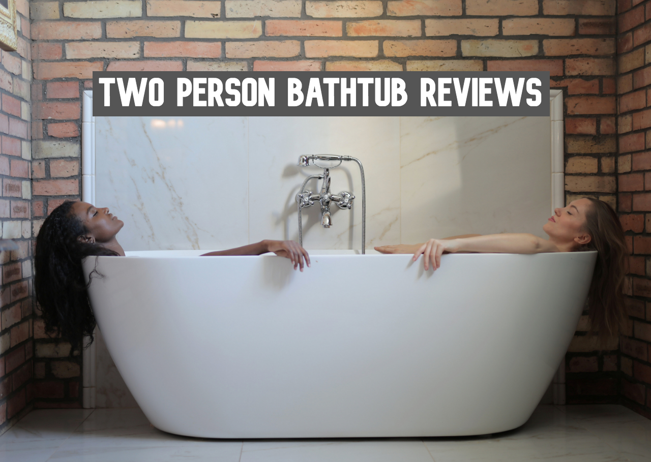 A couple laying down in one of the best two-person bathtubs