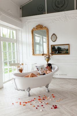 woman in acryilc clawfoot bathtub